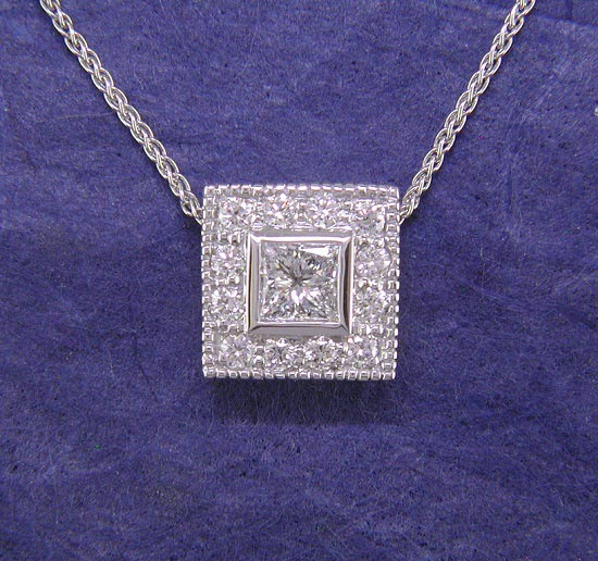 14K white gold halo pendant with princess cut center stone.