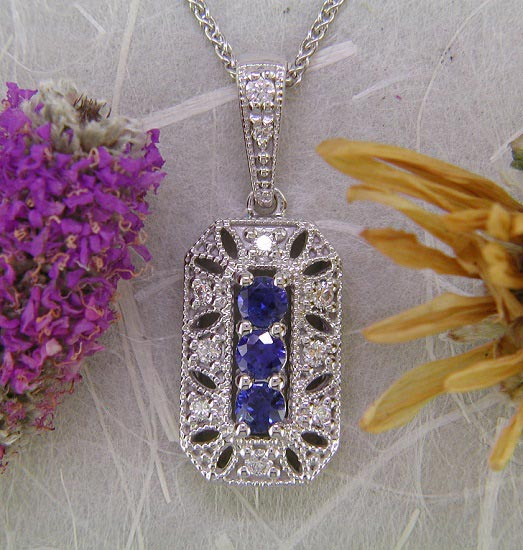14K white gold vintage style sapphire and diamond pendant.