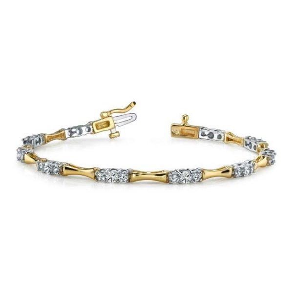 14K two-tone undulating tennis bracelet.