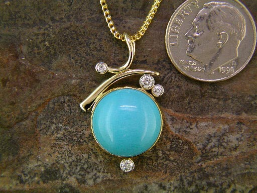 14K and 22K yellow gold with robin's egg turquoise and diamond.