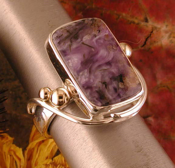 Sterling silver, 14K gold, and charoite from Russia.
