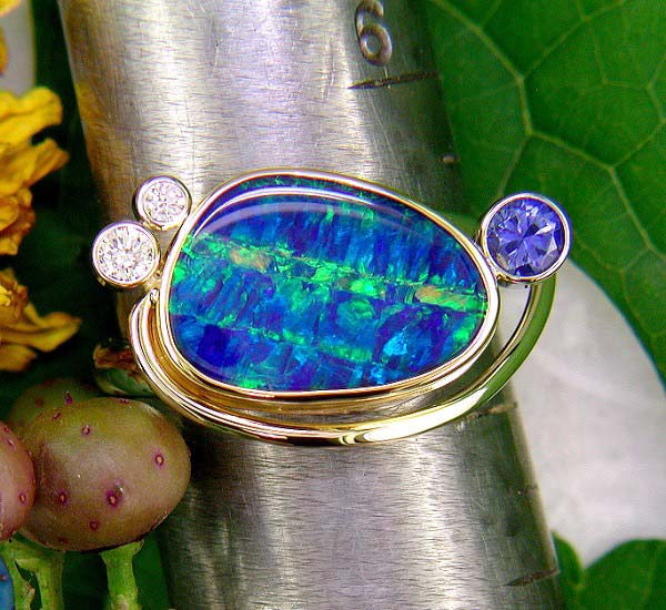 14K and 22K gold with opal doublet, diamond, and sapphire.