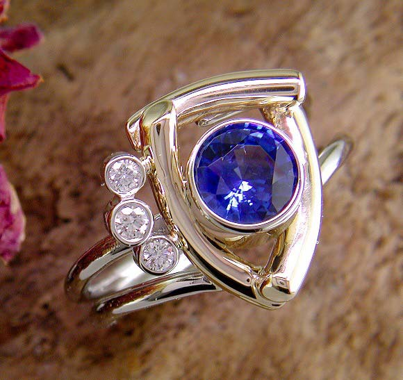 14K two-tone unique structural ring with blue sapphire.