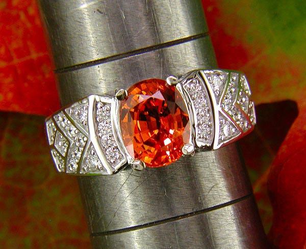 14K white gold ring with spessartite garnet and diamond.
