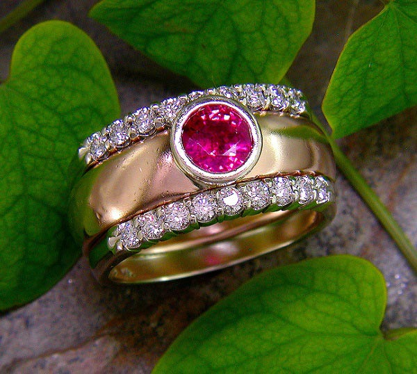 14K gold ring with bezel-set ruby and shared-prong diamonds.