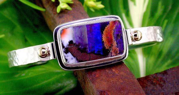 textured sterling silver cuff style bracelet with Australian boulder opal and 14K gold bead accents