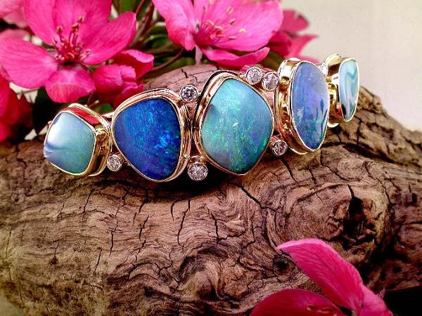 14K and 22K gold hinged bangle bracelet with boulder opal and diamond. A remarkable one of a kind.