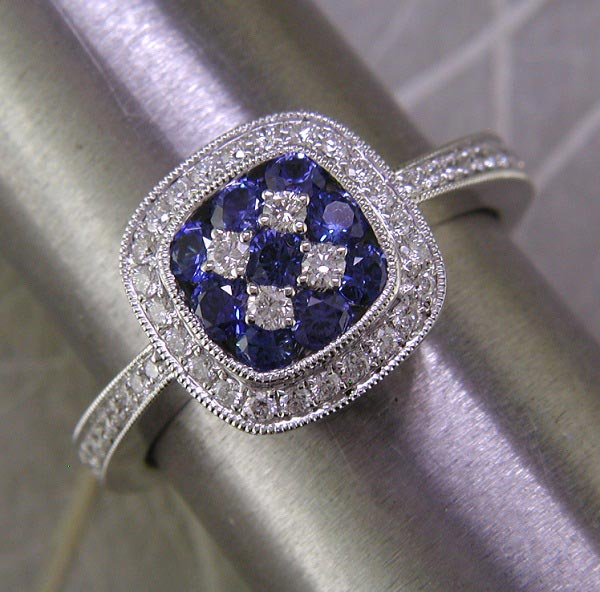 White gold, diamond, and blue sapphire ring. Also available in ruby or tsavorite (green) garnet.