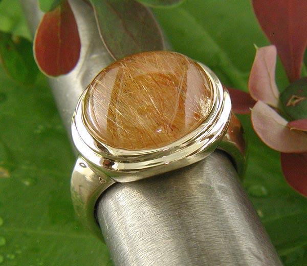14K gold and rutilated quartz ring.
