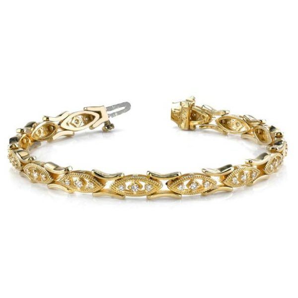 14K yellow gold milgrain detailed tennis bracelet. Try this on in white gold or two-tone!!!