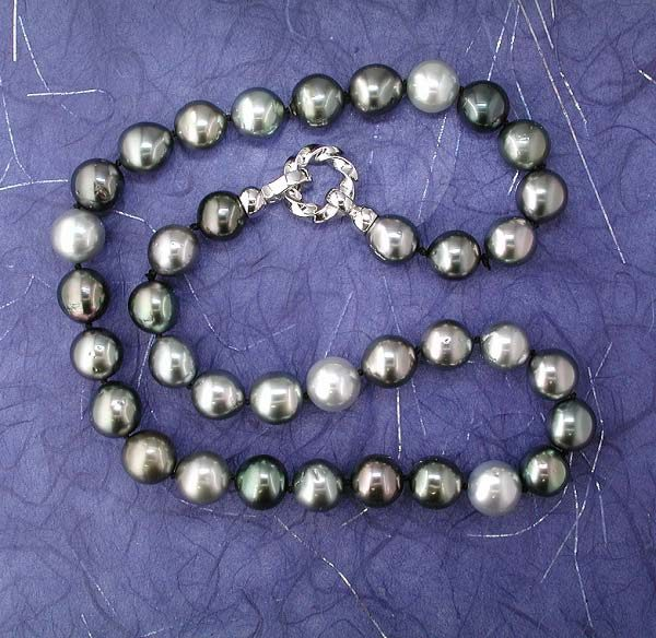 Natural color Tahitian South Seas pearl multi-colored strand finished with a 14K white gold clasp. Strands vary in color, size and price. Stop by to see what we have on hand at any given time!