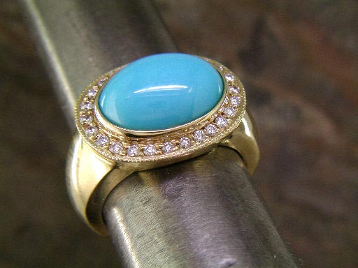 14K yellow gold with diamond and 14x10mm robin's egg turquoise.