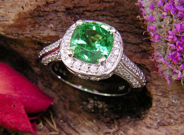 Tsavorite Garnet accented with round diamonds.