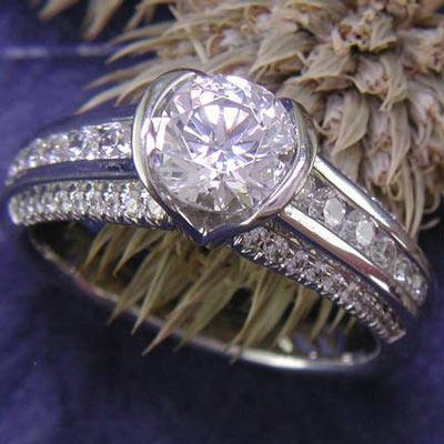 Semi-bezel set 14K white gold engagement ring.