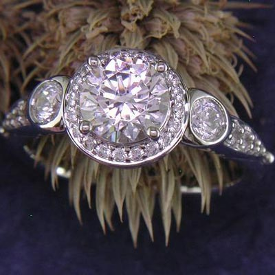 14K white gold sculptural halo engagement ring.