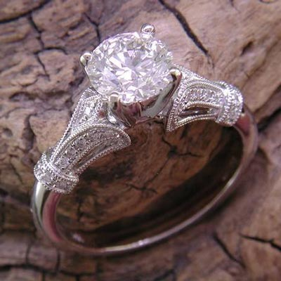 Vintage inspired 14K white gold milgrain detailed engagement ring shown with a round center stone.