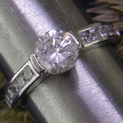 14K white gold channel-set engagement ring.