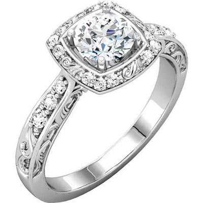 Sculptural halo engagement ring with round diamond center. Or how about set it with a blue sapphire center stone to make it a fashion ring instead?